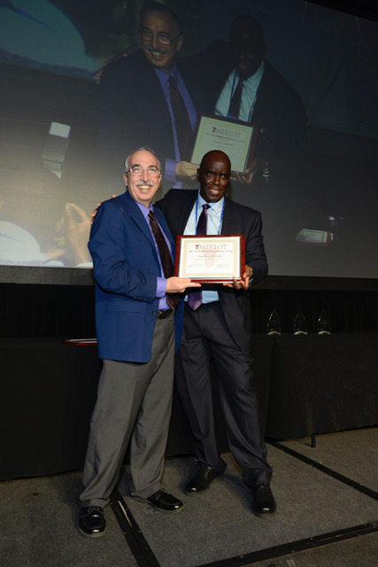 Moustapha Diack recieves an award from Gerry Hanley